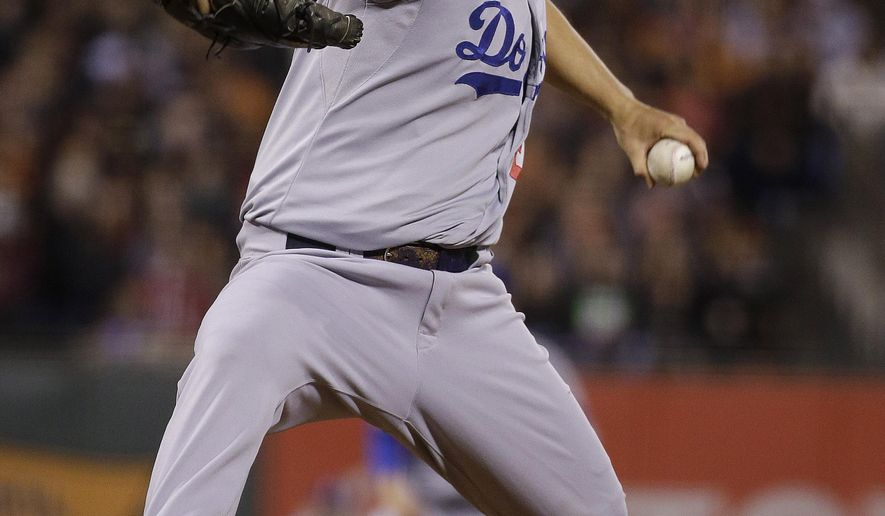 Los Angeles Dodgers pitcher Clayton Kershaw throws against the San Francisco Giants during the fourth inning of a baseball game in San Francisco, Tuesday, Sept. 29, 2015. (AP Photo/Jeff Chiu)