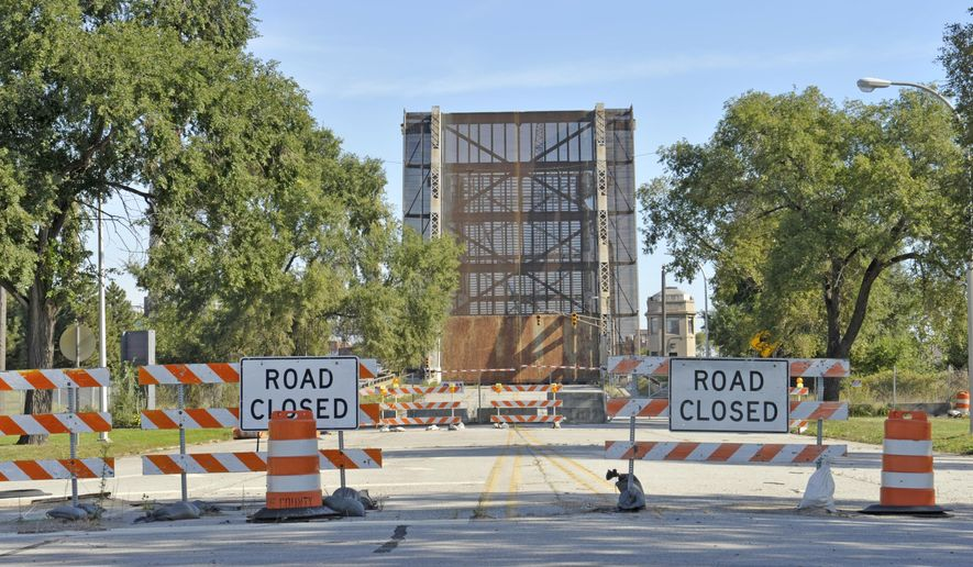 A Sept. 24, 2015 photo shows the Jefferson Avenue drawbridge over the Rouge River, which used to be a heavily traveled crossing between Detroit and River Rouge. Wayne County owns and maintains it. Officials say the drawbridge that's been closed since 2013 likely will be closed for another year. (Charles V. Tines/The Detroit News via AP)