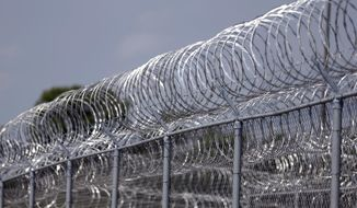"ADVANCE FOR USE SUNDAY, OCT. 4, 2015 AND THEREAFTER - This Tuesday, Aug. 18, 2015 photo shows razor wire surrounding the Rockville Correctional Facility in Rockville, Ind. Around 2007, the prison's superintendent Julie Stout noticed a change in inmate Paula Cooper. She participated in several programs at the facility; her favorite was culinary arts, where she excelled and became a tutor. ""She truly loved that,"" said Stout. ""She was always smiling."" (AP Photo/Michael Conroy)"