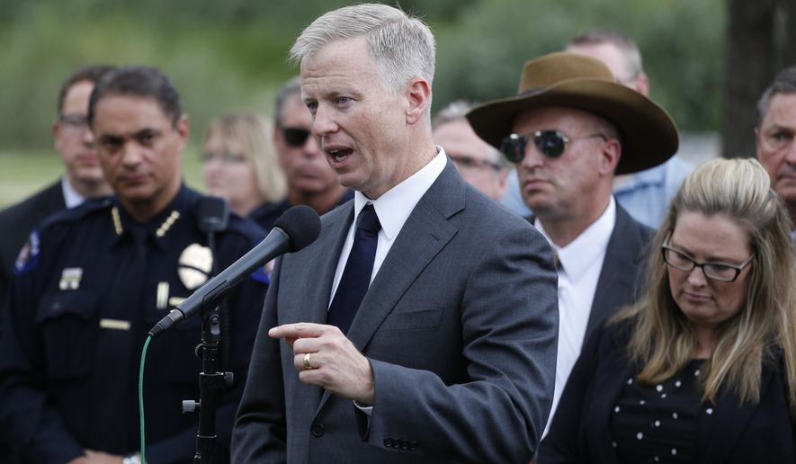 FILE - In this Aug. 7, 2015 file photo, Republican prosecutor George Brauchler speaks with members of the media following the reading of the jury's decision that Colorado theater shooter James Holmes will not receive the death penalty, outside the Arapahoe County District Court in Centennial, Colo. Brauchler, who led the case against the suburban movie theater shooter, has decided not to run for U.S. Senate against Democratic Sen. Michael Bennet.(AP Photo/Brennan Linsley, file)