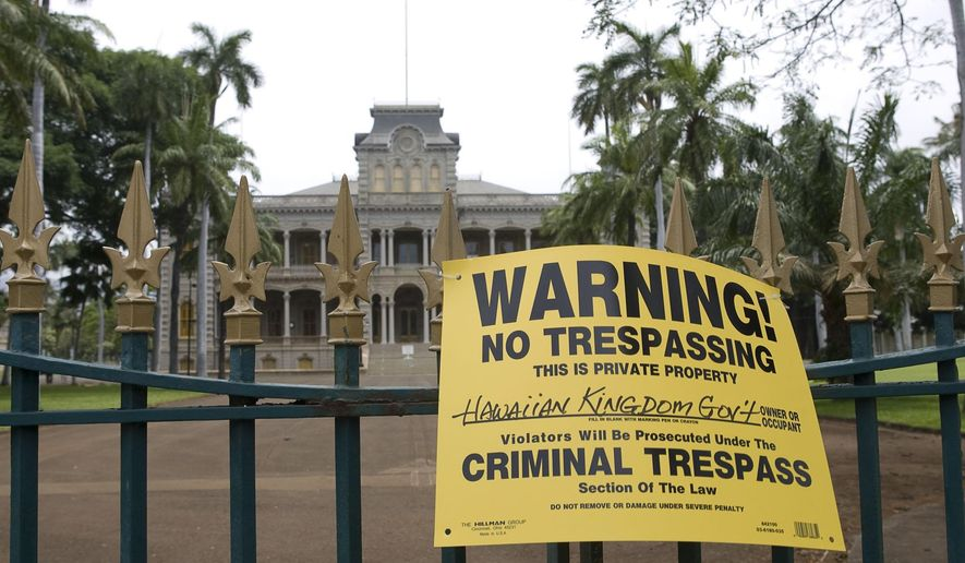 FILE - In this April 30, 2008 file photo, a sign is posted on the gate of the Iolani Palace in Honolulu after a Native Hawaiian group advocating sovereignty locked the gates of the historic palace.  Federal officials on Tuesday, Sept. 29, 2015, outlined a proposal that could establish a formal relationship between the United States and Native Hawaiians, if Native Hawaiians determine they want such a relationship. (AP Photo/Marco Garcia, File)