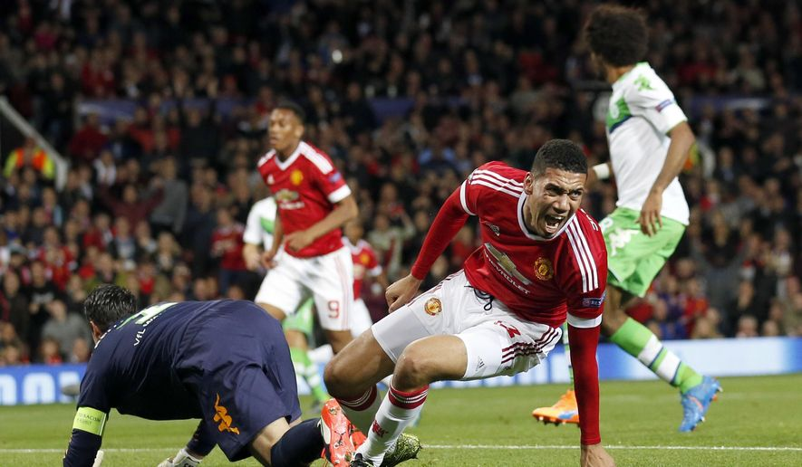 Manchester United's Chris Smalling reacts after scoring his side's 2nd goal during the Champions League Group B soccer match against VfL Wolfsburg at Old Trafford Stadium in Manchester, England, Wednesday, Sept. 30, 2015. (AP Photo/Jon Super)