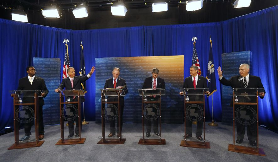Gubernatorial candidates ready themselves for a debate, sponsored by WDSU, at their studio in New Orleans, Thursday, Oct. 1, 2015. From left are:  Rev. Jeremy Odom, Louisiana Public Service Commissioner Dist. 2., Scott Angelle, state Rep. John Bel Edwards, D-Baton Rouge, Sen. David Vitter, R-La., Lt. Gov. Jay Dardenne, and attorney Cary Deaton. (AP Photo/Gerald Herbert)