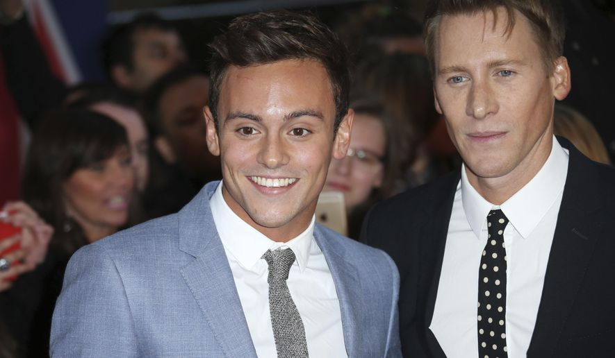 FILE - This is a  Monday, Sept. 28, 2015 file photo of British Olympic diver Tom Daley and Oscar-winning screenwriter Dustin Lance Black, right as they pose for photographers upon arrival at the Pride of Britain Awards 2015 in London. Tom Daley and Dustin Lance Black have announced their engagement. The announcement was published in The Times newspaper Thursday Oct. 1, 2015 but did not disclose a date for the marriage. (Photo by Joel Ryan/Invision/AP, File)