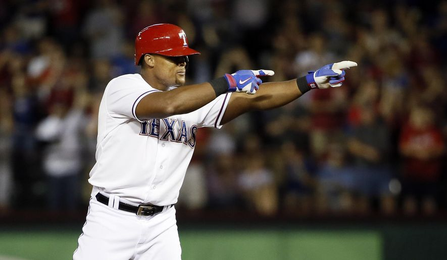 Texas Rangers' Adrian Beltre points to the dugout whiles standing on second after hitting a bases learning double off of Los Angeles Angels' Andrew Heaney in the fifth inning of a baseball game Thursday, Oct. 1, 2015, in Arlington, Texas. (AP Photo/Tony Gutierrez)