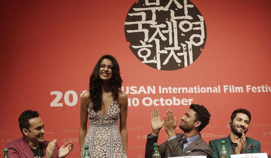 "Indian actress Sarah Jane Dias, second from left, is congratulated by Indian director Mozez Singh, left, actor Vicky Kaushal and actor Raaghav Chanana , right, after she sings a song during a press conference for the Busan International Film Festival opening movie "" Zubaan"" in Busan, South Korea, Thursday, Oct. 1, 2015. (AP Photo/Ahn Young-joon)"