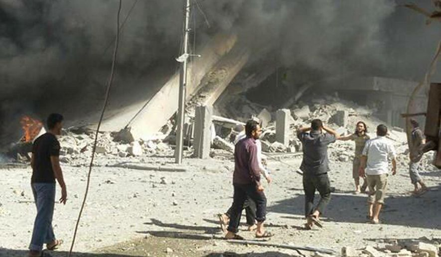 This image taken in Wednesday, Sept. 30, 2015 posted on the Twitter account of Syria Civil Defence, also known as the White Helmets, a volunteer search and rescue group, shows the aftermath of an airstrike in Talbiseh, Syria. Russia on Wednesday carried out its first airstrikes in Syria in what President Vladimir Putin called a pre-emptive strike against the militants. Khaled Khoja, head of the Syrian National Council opposition group, said at the U.N. that Russian airstrikes in four areas, including Talbiseh, killed dozens of civilians, with children among the dead. (Syria Civil Defence via AP)