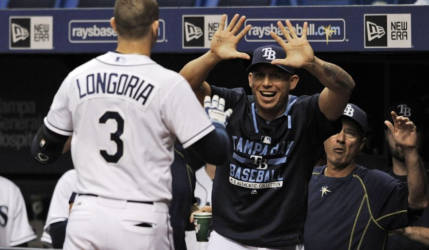 Tampa Bay Rays' Asdrubal Cabrera, center, greets Evan Longoria (3) after his solo home run during the first inning of a baseball game against the Miami Marlins Thursday, Oct. 1, 2015, in St. Petersburg, Fla. (AP Photo/Steve Nesius)