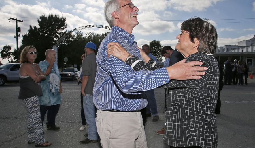 Kim Van Atta, left, a friend of death row inmate Richard Glossip, celebrates with death penalty opponent Sister Helen Prejean, right, outside the Oklahoma State Penitentiary in McAlester, Okla, Wednesday, Sept. 30, 2015, after Glossip's scheduled execution was postponed. Oklahoma Gov. Mary Fallin postponed an inmate's scheduled execution Wednesday, saying a drug that the state Department of Corrections had received to carry out a lethal injection didn't match those listed in the agency's protocols.  (AP Photo/Sue Ogrocki)