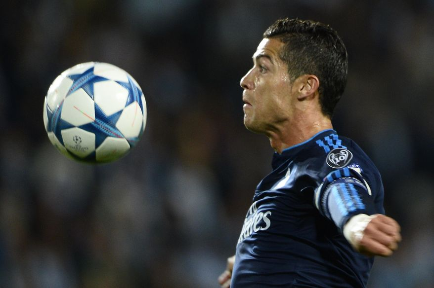 Real Madrid's Cristiano Ronaldo controls the ball during the UEFA Champions League group A football match between Malmo FF and Real Madrid at Malmo New Stadium in Malmo, Sweden, Wednesday Sept. 30, 2015. (Anders Wiklund / TT via AP) SWEDEN OUT