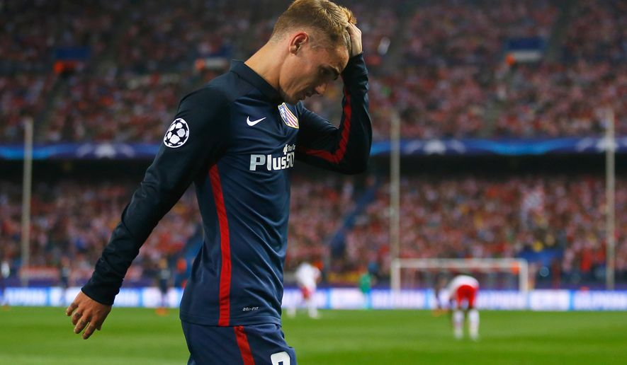 Atletico's Antoine Griezmann leaves the pitch after being substituted during the Champions League group C soccer match between Atletico de Madrid and Benfica at the Vicente Calderon stadium in Madrid, Wednesday, Sept. 30, 2015.  (AP Photo/Francisco Seco)