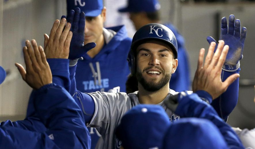 Kansas City Royals' Eric Hosmer celebrates in the dugout after scoring on a home run by Mike Moustakas, off a pitch from Chicago White Sox starting pitcher John Danks, during the third inning of a baseball game Thursday, Oct. 1, 2015, in Chicago. (AP Photo/Charles Rex Arbogast)