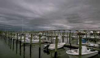 Clouds mark a low-pressure system moving into Somers Point, N.J., Wednesday, Sept. 30, 2015. A strengthening Hurricane Joaquin approached the central islands of the Bahamas on Wednesday evening, following a projected track that would take it near the U.S. East Coast by the weekend. (Vernon Ogrodnek/The Press of Atlantic City via AP)