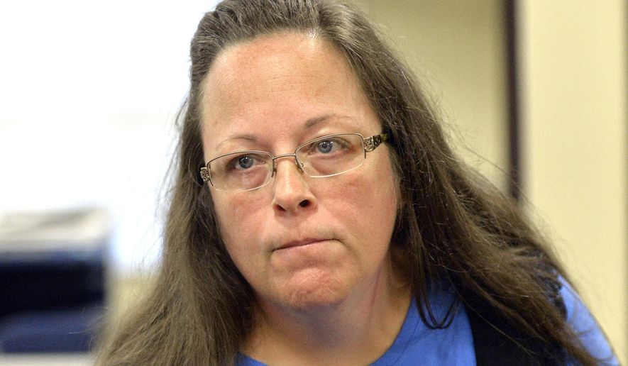 In this Tuesday, Sept. 1, 2015, file photo, Rowan County Clerk Kim Davis listens to a customer following her office's refusal to issue marriage licenses at the Rowan County Courthouse in Morehead, Ky. (AP Photo/Timothy D. Easley, File)