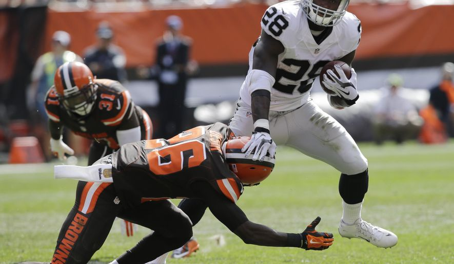 Oakland Raiders running back Latavius Murray (28) is tackled by Cleveland Browns cornerback Pierre Desir (26) in the second half of an NFL football game, Sunday, Sept. 27, 2015, in Cleveland. (AP Photo/Aaron Josefczyk)