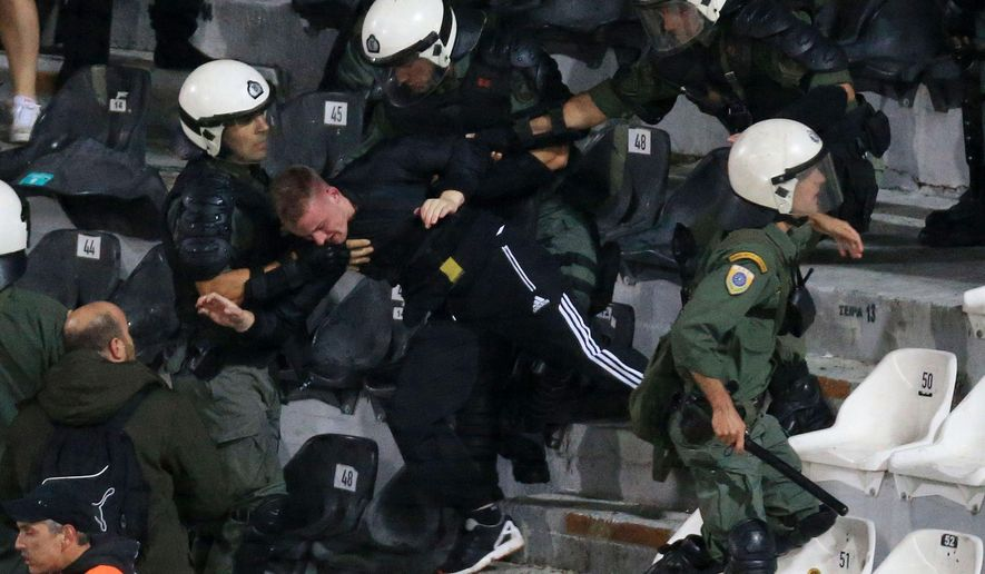Riot police detain Dortmund's fan during the Europa League Group C soccer match between PAOK and Borussia Dortmund at Toumba stadium in the northern Greek city of Thessaloniki, on Thursday, Oct. 1, 2015. (AP Photo)  GREECE OUT