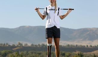 In this Sept. 24, 2015 photo, Cody High School golfer Sydney Pomajzl poses at the Three Crowns Golf Course in Casper, Wyo. Pomajzl, 16, was born with a defective leg which had to be amputated below the knee when she was 13 months old. (Dan Cepeda/The Casper Star-Tribune via AP) MANDATORY CREDIT