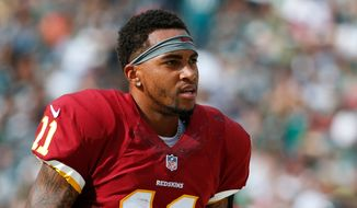 Washington Redskins' DeSean Jackson walks the sidelines during the second half of an NFL football game against the Philadelphia Eagles, Sunday, Sept. 21, 2014, in Philadelphia. (AP Photo/Matt Rourke)