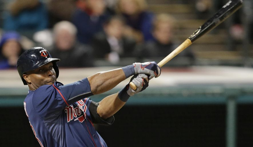 Minnesota Twins' Torii Hunter hits an RBI-sacrifice fly off Cleveland Indians relief pitcher Cody Allen in the ninth inning of a baseball game, Thursday, Oct. 1, 2015, in Cleveland. Eddie Rosario scored on the play. (AP Photo/Tony Dejak)