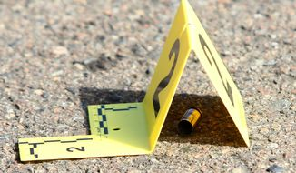 A bullet casing is marked at the scene of a deadly shooting at Umpqua Community College in Roseburg, Ore., Thursday, Oct. 1, 2015. (Michael Sullivan/The News-Review via AP) ** FILE **