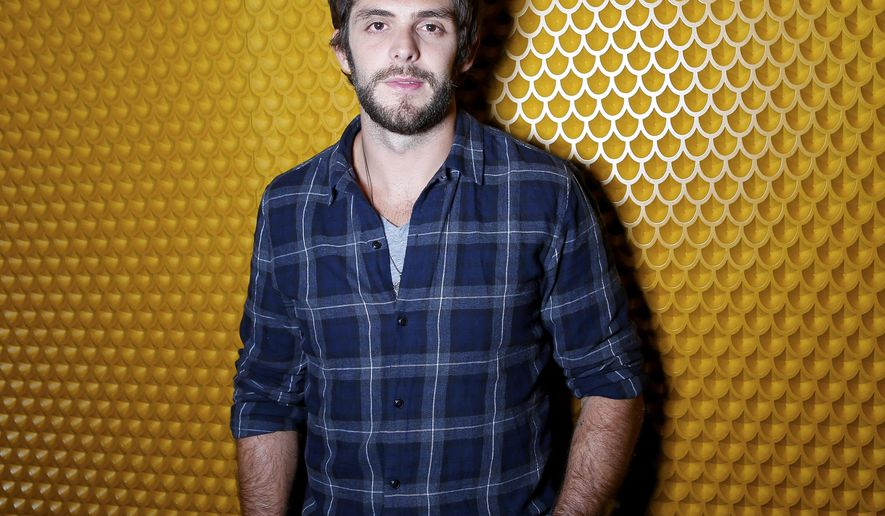 "In this Sept. 15, 2015 photo, country singer Thomas Rhett poses for a photo at Sinema Restaurant & Bar in Nashville, Tenn., to promote his latest album, ""Crash and Burn."" (Photo by Donn Jones/Invision/AP)"