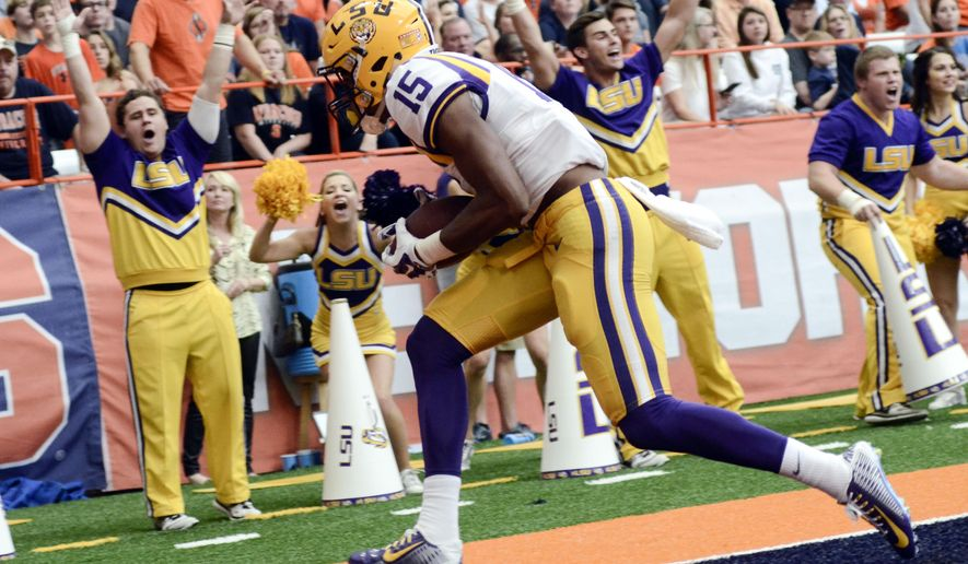 FILE - In this Sept. 26, 2015, file photo, LSU wide receiver Malachi Dupre (15) scores a touchdown during the second half of an NCAA college football game against Syracuse in Syracuse, N.Y. Dupre says he appreciates that the ninth-ranked Tigers can't look to throw at the expense of a dominant running game led by Heisman candidate Leonard Fournette. So Dupre and fellow receivers figure they'll have to make the best of limited chances, as they showed they could do last week. (AP Photo/Heather Ainsworth, File)