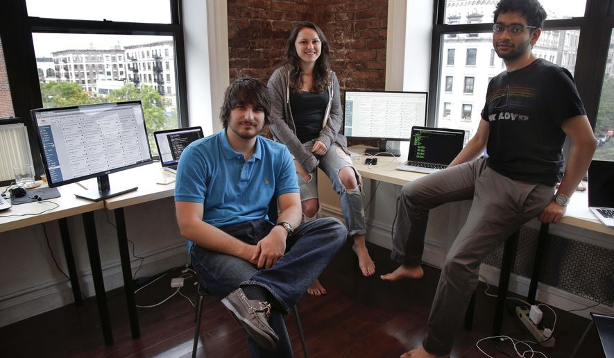 Draftpot co-founder and CEO Joey Levy, left, sits for a photo with co-founder and developer Jessica Vandebon, center, and co-founder and CTO Joshua Hughes at the Fantasy Football operation's office, Wednesday, Sept. 30, 2015, in New York. After starting up from their dorm rooms at Columbia University earlier this year, the operation paid out $220,000 in it's first week online. (AP Photo/Julie Jacobson)
