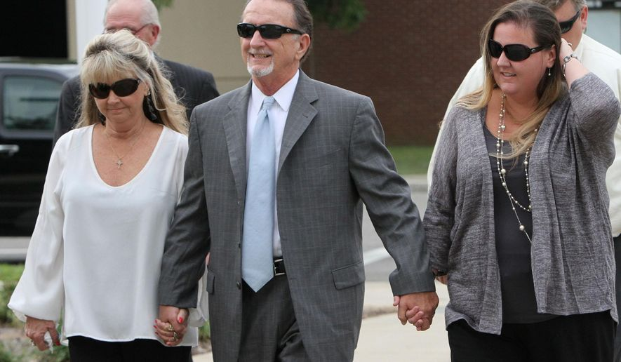 Former Harrison County Supervisor Kim Savant, center, arrives at the Dan M. Russell federal courthouse in Gulfport, Miss., on Thursday Oct. 1, 2015 for sentencing on bribery charges. Savant has been sentenced to five years in prison.  (John Ftizhugh/The Sun Herald via AP) LOCAL TELEVISION OUT; MANDATORY CREDIT: MISSISSIPPI PRESS OUT; LOCAL TELEVISION OUT WLOX, LOCAL ONLINE OUT; GULFLIVE.COM OUT
