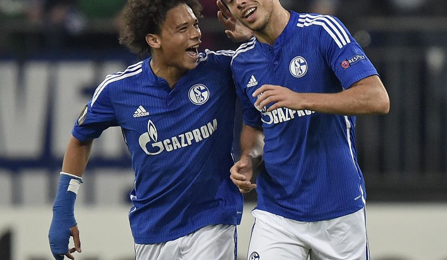 Schalke's scorer Franco di Santo, right, is congratulated by teammate Leroy Sane, left, after scoring the opening goal during the Europa League group K soccer match between FC Schalke 04 and Asteras Tripolis FC in Gelsenkirchen, Germany, Thursday, Oct. 1, 2015. (AP Photo/Martin Meissner)