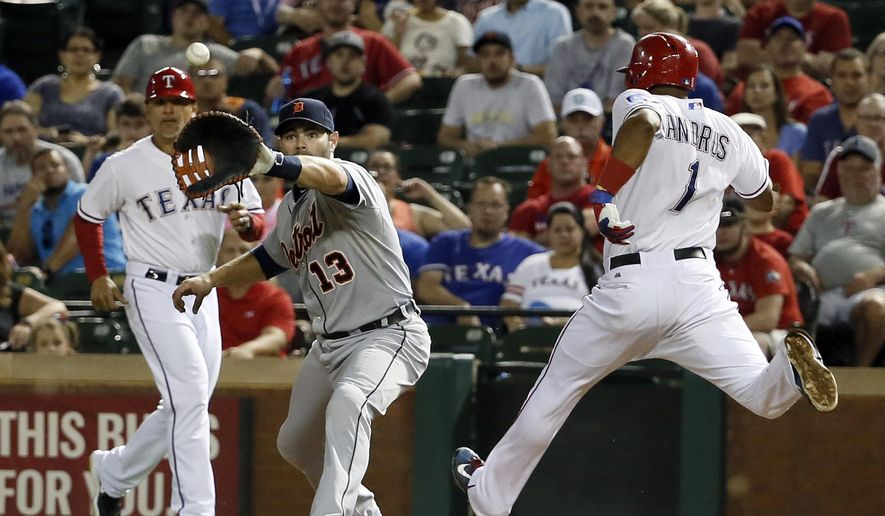 Detroit Tigers first baseman Alex Avila (13) reaches out to grab the throw from third baseman Nick Castellanos on a ground out by Texas Rangers' Elvis Andrus in the eighth inning of a baseball game Wednesday, Sept. 30, 2015, in Arlington, Texas. (AP Photo/Tony Gutierrez)