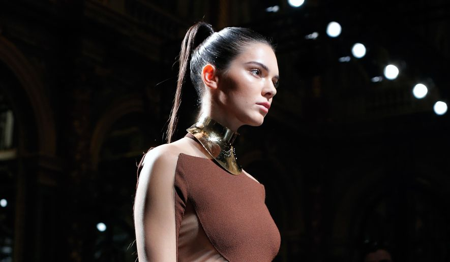 Kendall Jenner wears a creation for Balmain as part of the Spring-Summer 2016 ready-to-wear fashion collection presented, during the Paris Fashion Week, in Paris, Thursday, Oct. 1, 2015.  (AP Photo/Thibault Camus)