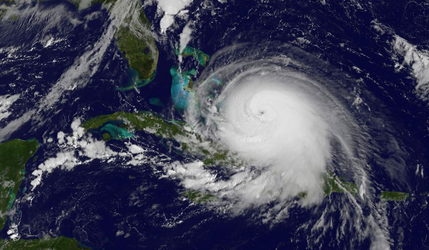 This satellite image taken Thursday at 9:37 a.m. EDT shows Hurricane Joaquin. Forecasters said the powerful Category 4 hurricane could grow more intense while following a path that would near the U.S. East Coast by the weekend. (NOAA via AP)