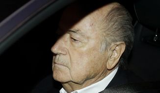 FIFA President Sepp Blatter drives his car into the garage of the FIFA headquarters on his way to work in Zurich, Switzerland, Tuesday, Sept. 29, 2015. Blatter was questioned by Swiss investigators on Friday about why FIFA paid 2 million Swiss francs (about $2 million) to UEFA President Michel Platini in 2011 for work supposedly carried out at least nine years earlier. (AP Photo/Michael Probst)