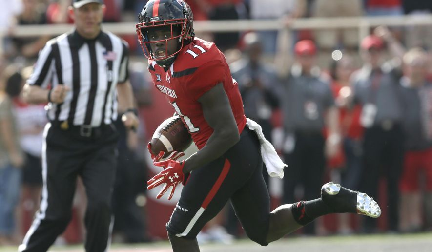 FILE - In this Sept. 26, 2015, file photo, Texas Tech wide receiver Jakeem Grant (11) runs in for a touchdown after a reception in the first half of an NCAA college football game against TCU in Lubbock, Texas. Baylor, West Virginia, Texas Tech and TCU all have a 100-yard rusher and a 100-yard receiver. The rest of the power-five conferences have only one such team, plus Notre Dame.(AP Photo/LM Otero, File)