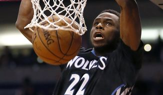 FILE - In this Jan. 16, 2015, file photo, Minnesota Timberwolves' Andrew Wiggins dunks against the Phoenix Suns during the first half of an NBA basketball game in Phoenix. The NBA kicks off its Canada series on Sunday, Oct. 4,  the first of a record four preseason games played across the country. With Timberwolves forward and Canadian sensation Andrew Wiggins headlining the series, the NBA is hoping to make serious in-roads in a nation dominated by hockey. (AP Photo/Matt York, File)