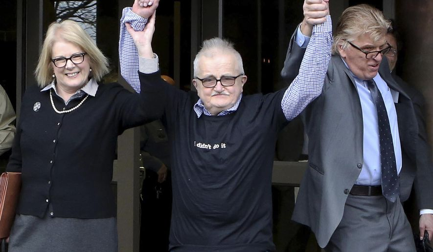 FILE - In this April 10, 2015, file photo, Richard Lapointe, center, raises his arms with Kate Germond, left, Centurion Ministries co-director, and Paul Casteleiro, Centurion Ministries legal director, after he was granted bail and released at the Connecticut Supreme Court in Hartford Conn. A Connecticut judge dismissed charges Friday, Oct. 2, 2015, against the mentally disabled former dishwasher who was convicted of killing his wife's 88-year-old grandmother in 1987 and spent almost 26 years in prison. (Jared Ramsdell/Journal Inquirer via AP, File)   MANDATORY CREDIT