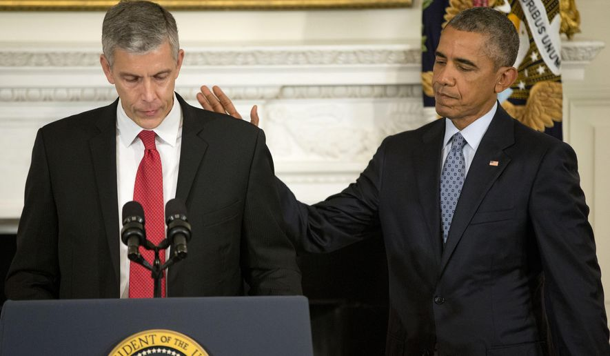 President Barack Obama pats Education Secretary Arne Duncan's back in the State Dining Room of the White House in Washington, Friday, Oct. 2, 2015, as Duncan  announced that he will be stepping down in December after 7 years in the Obama administration. Duncan will be returning to Chicago and Obama has appointed senior Education Department official, John King Jr., to oversee the Education Department. (AP Photo/Pablo Martinez Monsivais)