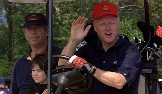 President Clinton waves to reporters as brother-in-law Tony Rodham (left) and his son Zach Rodham join him for a round of golf at Maple Run Golf Course in Thurmont, Md., on Aug. 14, 1999. (Associated Press) **FILE**