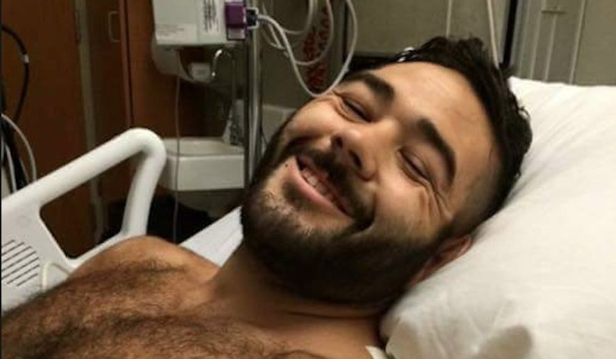 Chris Mintz, 30, recovering after surgery to remove several bullets from his body. Witnesses said the Army veteran heroically charged at the gunman to save others during the Umpqua Community College attack. (Image: Screen grab from imgur user goofygoober_75)