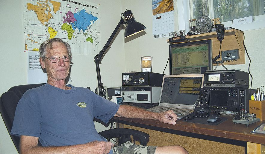 In this photo taken Sept. 16, 2015, amateur radio operator Jerry Pyle, of Basin, Wyo., sits in his radio room complete with transceiver, transmitter and receiver, computers and maps to keep track of other operators he contacts. (Karla Pomeroy/Northern Wyoming Daily News via AP) MANDATORY CREDIT