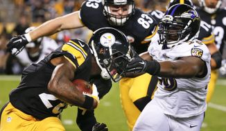 Pittsburgh Steelers running back Le'Veon Bell, left, runs the ball as Baltimore Ravens outside linebacker Elvis Dumervil, right, pursues in the first quarter of an NFL football game, Thursday, Oct. 1, 2015 in Pittsburgh. (AP Photo/Gene J. Puskar) **FILE**