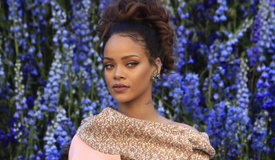 Singer Rihanna poses before Christian Dior's Spring-Summer 2016 ready-to-wear fashion collection to be presented during the Paris Fashion Week, in Paris, France, Friday, Oct. 2, 2015. (AP Photo/Thibault Camus)