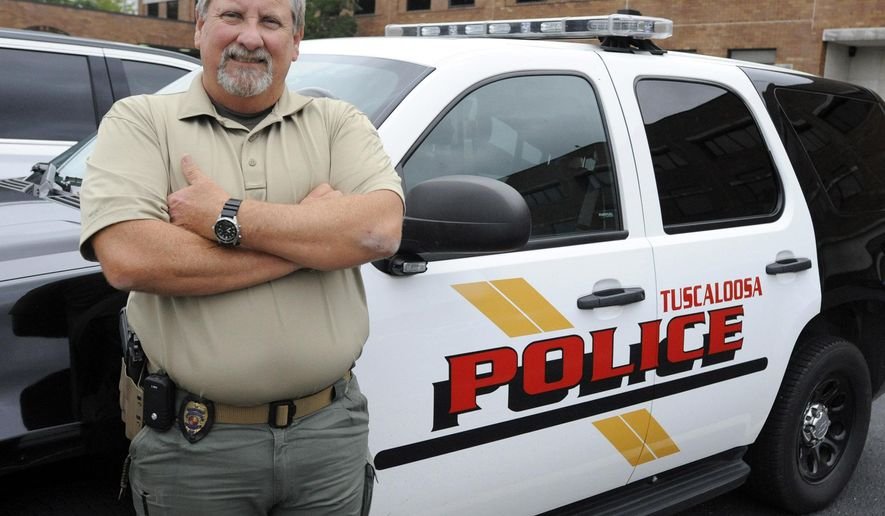 This photo taken Wednesday, Sept. 30, 2015, in Tuscaloosa, Ala., shows police Capt. Mike Flowers, who is retiring after 35 years without a sick day. Flowers, who also didn't miss school after a bout with measles in the first grade, said his parents taught him to get up and get going each day. (AP Photo/Jay Reeves)