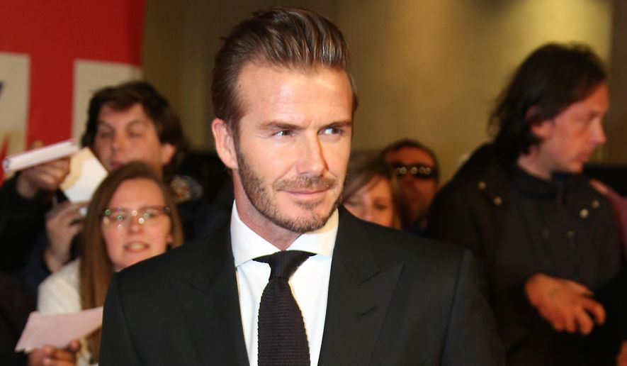 David Beckham poses for photographers upon arrival at the Pride of Britain Awards 2015 in London, Monday, Sept. 28, 2015. (Photo by Joel Ryan/Invision/AP)