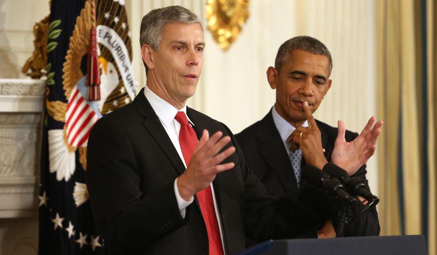 Education Secretary Arne Duncan with President Obama (AP Photo/File)