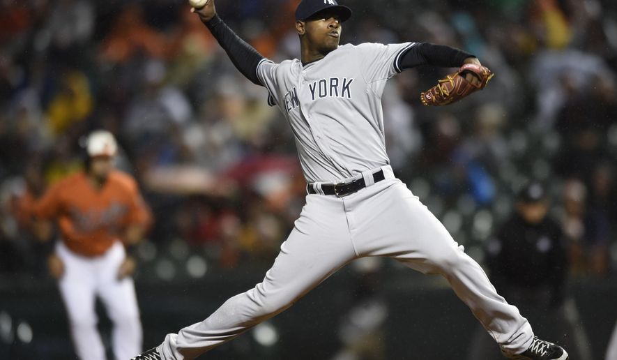 New York Yankees pitcher Luis Severino delivers in the first inning of the second baseball game of a doubleheader against the Baltimore Orioles in Baltimore, Saturday, Oct. 3, 2015. (AP Photo/Gail Burton)