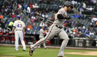 Washington Nationals' Bryce Harper (34) rounds the bases after hitting a two-run home run off of New York Mets relief pitcher Addison Reed (43) in the eighth inning of the first baseball game of a doubleheader, Saturday, Oct. 3, 2015, in New York. The Nationals won 3-1. (AP Photo/Kathy Kmonicek)