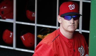 Washington Nationals manager Matt Williams stands in the dugout before a baseball game against the Cincinnati Reds at Nationals Park, Monday, Sept. 28, 2015, in Washington. (AP Photo/Alex Brandon)