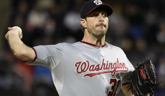 Washington Nationals starter Max Scherzer (31) pitches against the New York Mets in the first inning of the second baseball game of a doubleheader, Saturday, Oct. 3, 2015, in New York. (AP Photo/Kathy Kmonicek)