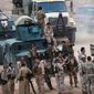 Kurdish peshmerga troops are taking back territory in northern Iraq in a survivalist fight against Islamic State invaders who have commandeered hundreds of American vehicles. The Kurdish forces say they are outgunned and need armor-piercing projectiles. (Associated Press photographs)